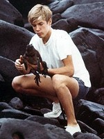 Young Bob in Galapagos with marine iguana